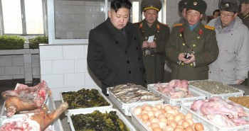 North-Korean-leader-Kim-Jong-Un-L-looks-at-food-at-a-kitchen-of-a-mess-hall-749215