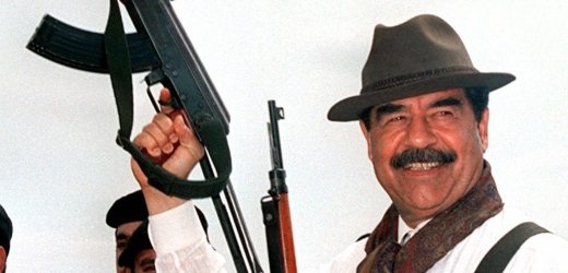 (FILES)-This photograph, released by Iraqi News Agency 29 March 1998 shows Iraqi President Saddam Hussein brandishing a Russian-made AK 47 assault rifle during his visit to villages in northern Iraq. Ousted Iraqi president Saddam Hussein has been captured in a raid by US forces backed by Kurdish fighters 14 December 2003 in his northern hometown of Tikrit, a senior Kurdish official told AFP. AFP PHOTO/INA